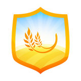 Orange Badge with Farm Field of Wheat on Shield. Orange Badge in form of a Shield with Farm Field of Wheat, Vector Illustration isolated on white Royalty Free Stock Images