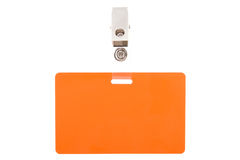 Orange badge with metal clip. Isolated on white background royalty free stock photos