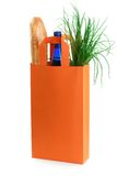 Orange bag with grocery goods Royalty Free Stock Photos