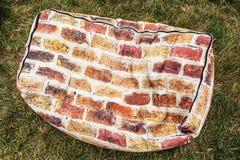 Orange bag seating with brick pattern Stock Photos