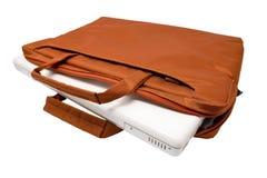 Orange bag and white laptop Stock Photography