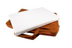 Orange bag and white laptop Stock Photo