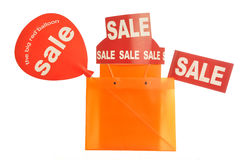 Orange bags filled up with sale signs Stock Photos