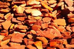 Orange bakgrund av den naturliga bergstenen, begrepp av naturliga byggnadsmaterial, closeup Arkivbild
