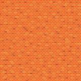 Orange bakgrund för modell för tegelstenvägg Royaltyfri Foto
