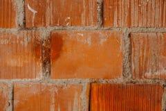 Orange bakgrund för textur för tegelstenvägg Arkivbilder