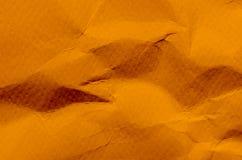 Orange bakgrund och tapet vid skrynklig pappers- textur och fr royaltyfri foto