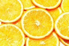 Orange bakgrund Skivor av den nya orange fruktcloseupen hälsa Arkivbild