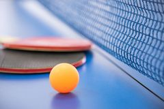 Free Orange Ball For Table Tennis And Two Rackets Of Red And Black Co Royalty Free Stock Image - 116774746