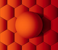 Orange ball on honeycombs Royalty Free Stock Photography