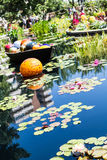 Orange Ball and Lilly Pads Royalty Free Stock Images