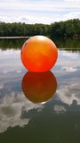 The orange ball. The ball in the sky at the lake Royalty Free Stock Photos
