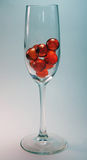 Orange Balls. In wine glass Royalty Free Stock Images
