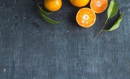 Orange on blackboard and paper. 4 orange balls on paper and paper on blackboard Royalty Free Stock Photography