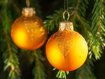 Orange balls on spruce, part of the Christmas tree with Christmas decorations.  stock images