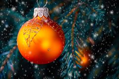 Orange balls on spruce, part of the Christmas tree with Christmas decorations.  royalty free stock photo