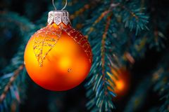 Orange balls on spruce, part of the Christmas tree with Christmas decorations.  stock photos