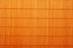 Orange bamboo mat Stock Images