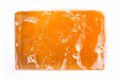 Orange Bar of Glycerin Soap  on White Background Royalty Free Stock Photography