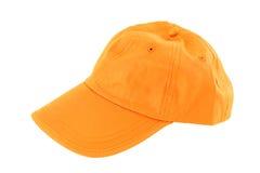 Orange Baseballmütze stockbild
