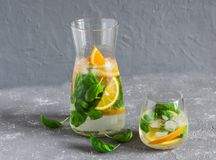 Orange basil infused detox water on a gray background. Vegetarian, weight loss concept Royalty Free Stock Photo
