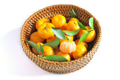 Orange in basket Royalty Free Stock Images