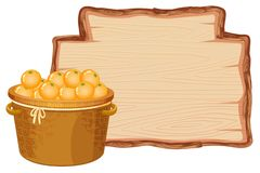 Free Orange Basket On Wooden Board Stock Images - 133527774