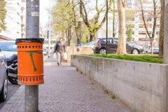 Orange basket for rubbish Stock Photos