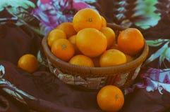 Orange in basket Stock Photo