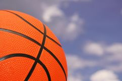 Orange basketball. Against cloudy sky Stock Photography