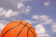 Orange basketball. Against the  cloudy sky Stock Images