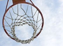 An orange basketball hoop. Against a blue sky Royalty Free Stock Images