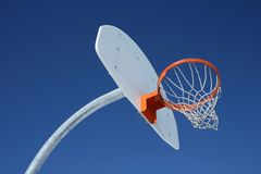 Orange basketball hoop. Against the blue sky royalty free stock photography