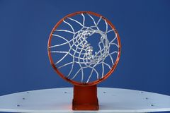 Orange basketball hoop and the blue sky. Orange basketball hoop against the deep blue sky royalty free stock photo