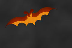 Orange bat flying on black background Royalty Free Stock Photography