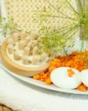 Orange bath sal, towel, sponge and stones. Stock Image