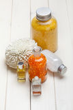 Orange bath salt and essential oil Stock Photos