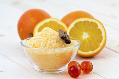 Orange bath salt with fresh fruits Stock Images