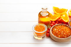 Orange bath salt and fruits Royalty Free Stock Photos