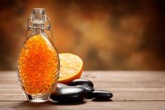 Orange bath salt and stones Royalty Free Stock Photo