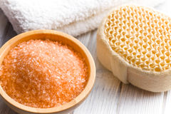 Orange bath salt in wooden bowl Royalty Free Stock Photography