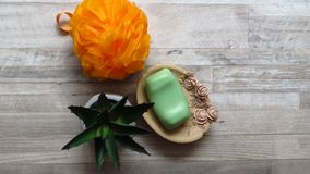 Orange Bath Sponge, Rose Decorated Soap Tray, Green Soap, Aloe Vera. Body care. Orange Puffy Bath Sponge, Rose Decorated Soap Tray, Green Soap, Aloe Vera. Body stock image