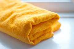 Orange bath towel Stock Images