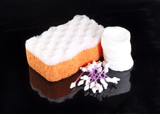Orange bathing sponge with white cotton discs and cotton sticks Stock Images