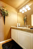 Orange bathroom interior with white cabinet Royalty Free Stock Images
