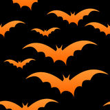 Orange bats on black, seamless Royalty Free Stock Images