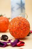 Orange bauble with christmas background. Christmas elements isolated on light yellow background Royalty Free Stock Photo