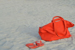 Orange beach bag and flip flops Stock Image