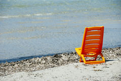 A orange beach chair Royalty Free Stock Photos