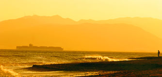 Orange Beach Panoramic. Orange Beach Scene with mountains and a ship in the background Royalty Free Stock Photo